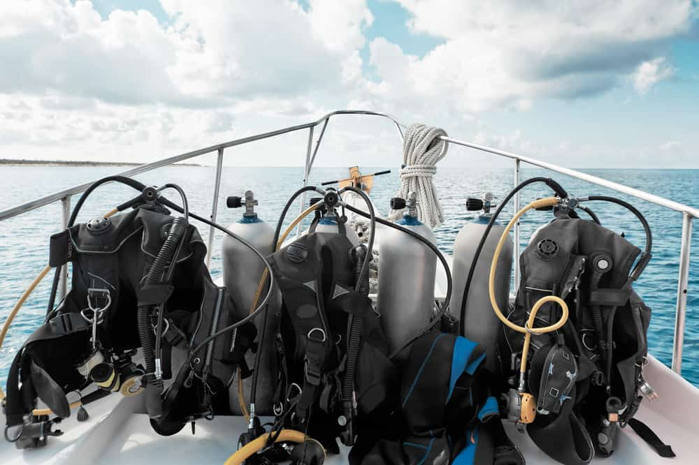 diving equipment piled up on a boat