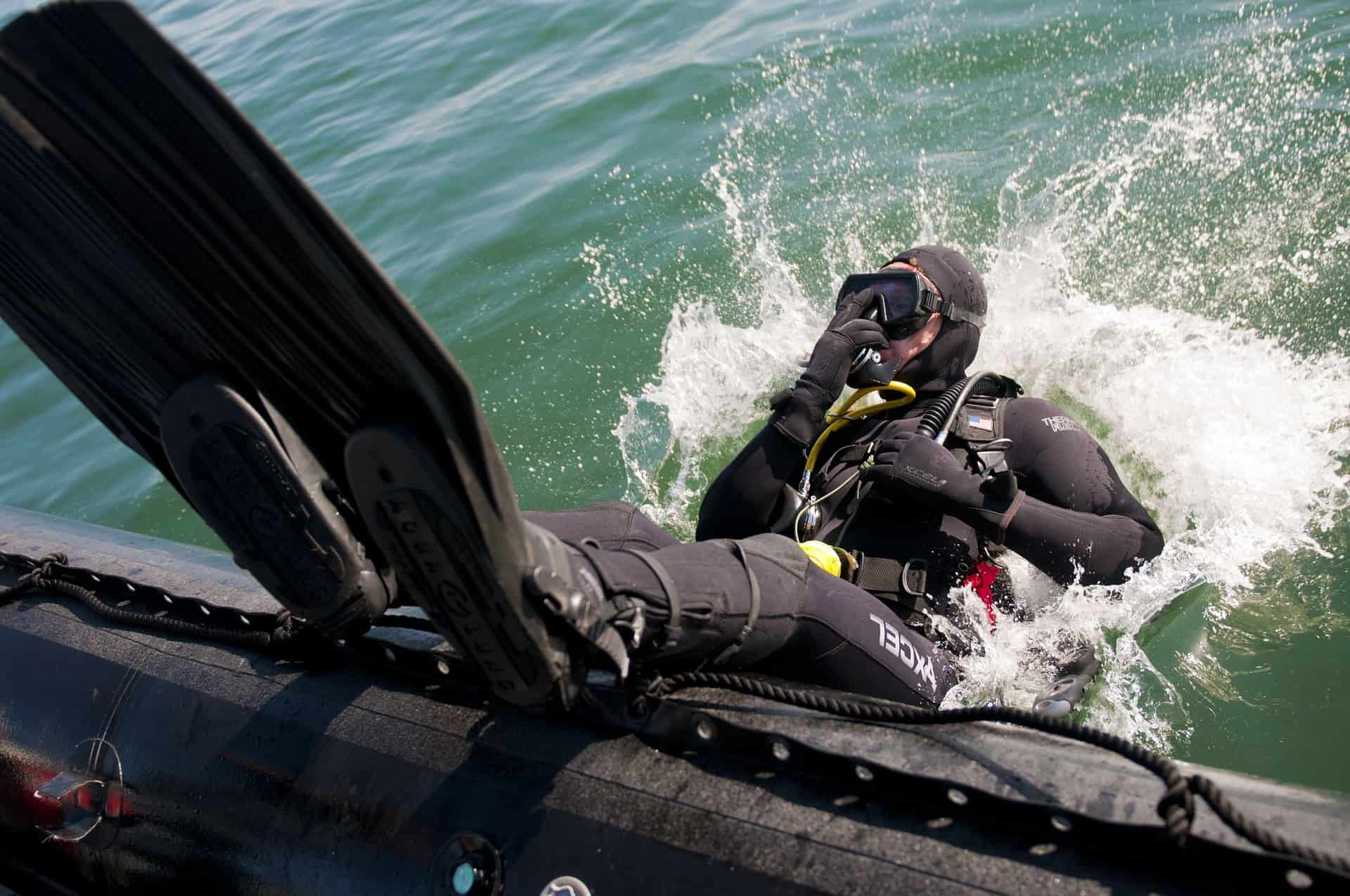 Diver entering the water through a backward role