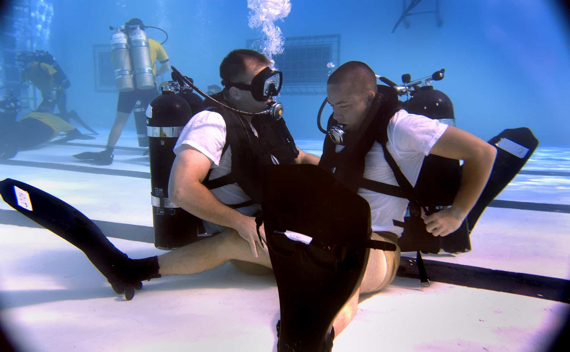 Training in a pool to get certified as a diver