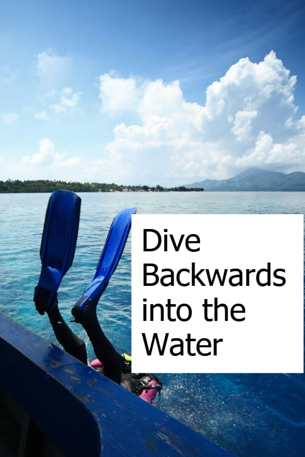 Scuba Diver diving backwards into the water