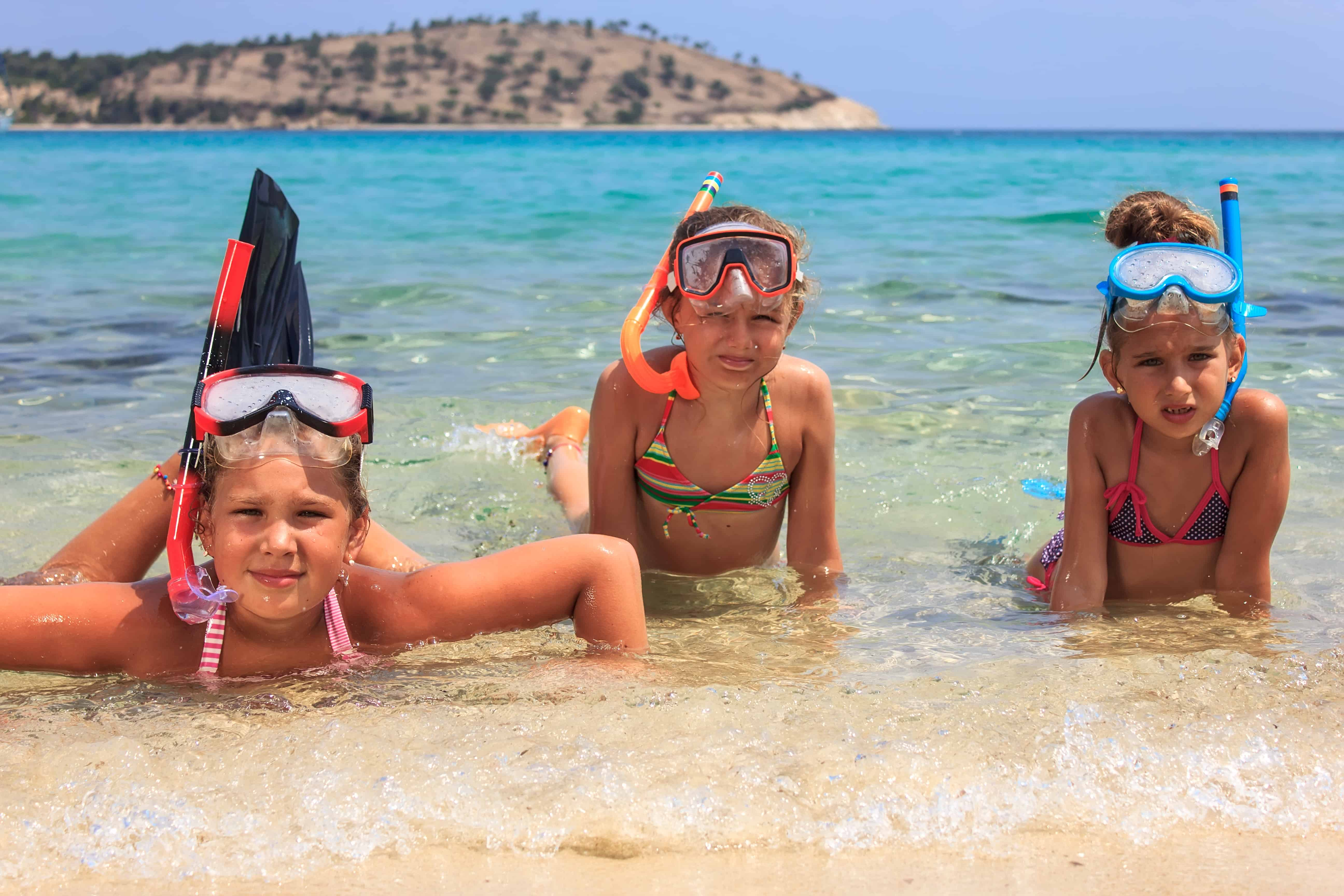Three girls snorkeling in the ocean