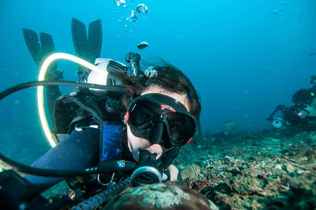 Diver underwater with Console-mounted dive computer