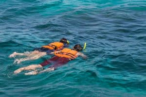 Using a snorkel vest to stay afloat