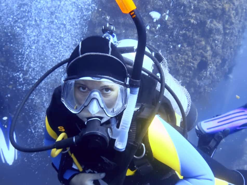 Scuba Diver with snorkel on left