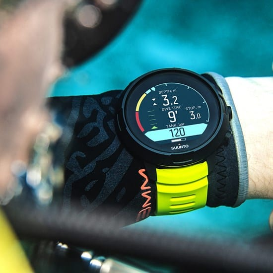 Suunto D5 yellow on wrist - monitoring all essential dive parameters including Air Nitrox on an easy to read display and alerts to warn about safety stop violations, etc.